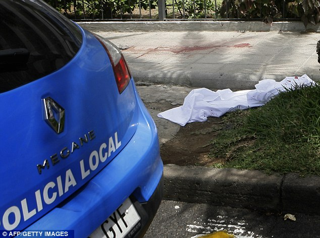 Trail: Blood stains remain on the pavement next to a white sheet after the atrocity in the tourist resort
