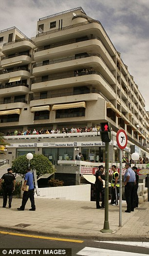 Policemen secure the area around a supermarket: Dozens of people had come out of their apartments to find out what had happened