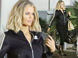 January 25, 2016 - Khloe Kardashian leaving the studio wearing Adidas warm up jacket and slippers after filming for the day.