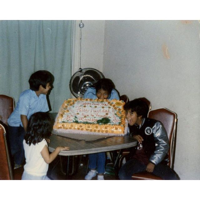 "~Christmas Cake~ 12/1985 Left to Right: Laura , Abel , Sonia, and Cesar Murillo on Christmas Morning. Laura Murrilo notes -"" My Father Juan Murillo was a baker and although he could not afford to buy the family gifts, he made sure to bake a cake for the family."" Juan Murillo was the one who photographed this moment with his children showcasing their Christmas/ New Years cake 1985/1986 (also #RaidersNation )"