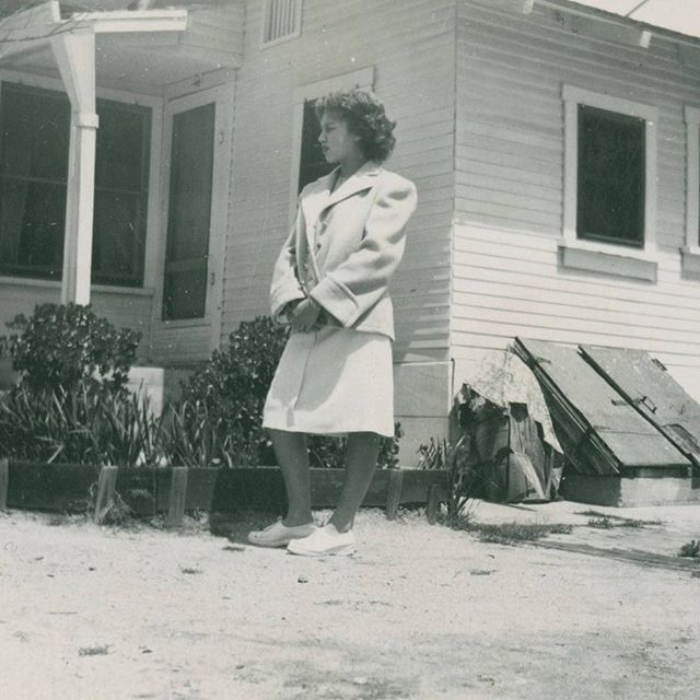 Young woman in the backyard of a house house on E. 6th Street, #EastLosAngeles, circa 1948.